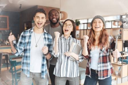 Group of happy people expressing success