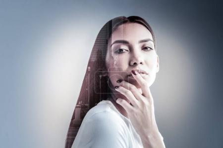 Portrait of attractive brunette that covering mouth