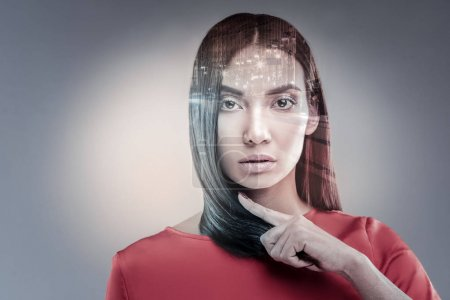 Serious female person posing on camera
