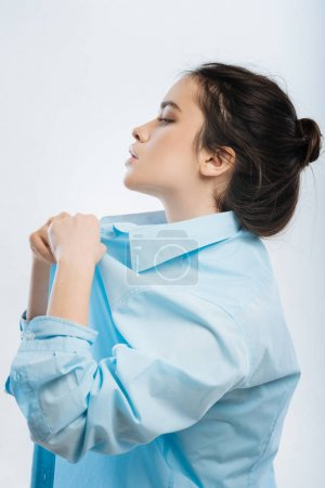 Thoughtful strong woman getting dressed