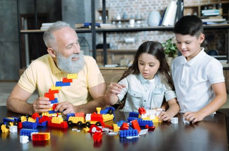Joyful family playing with building block at home