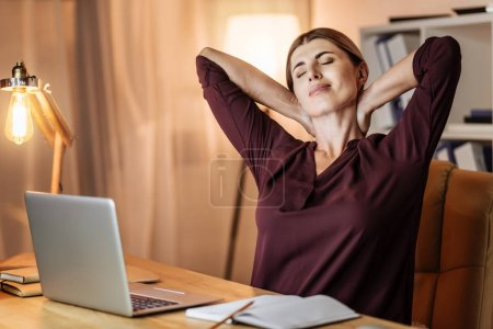 Relaxed woman keeping eyes closed