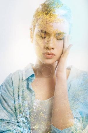 Photo for Forgotten memories. Pretty thoughtful calm girl touching her face closing eyes and dreaming in the empty room. - Royalty Free Image
