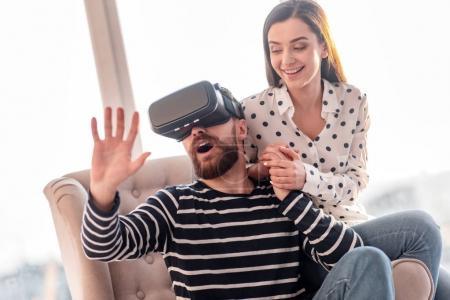 Stricken amazed man essaying VR