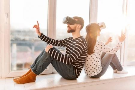 Attractive young couple spending time in VR