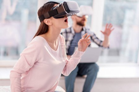 Amazed surprised woman watching with VR headset
