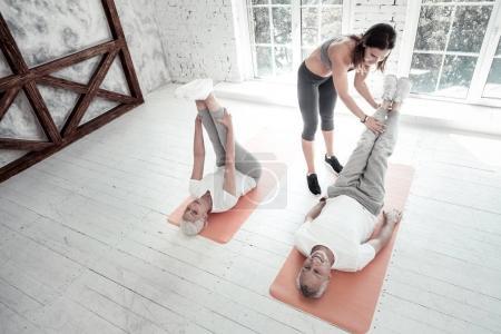 Sporty senior people training at gym