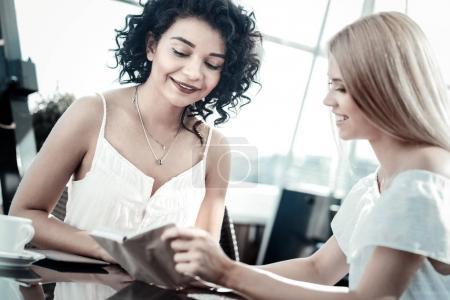 Joyful happy women talking to each other