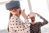 Amazed tender woman setting VR glasses