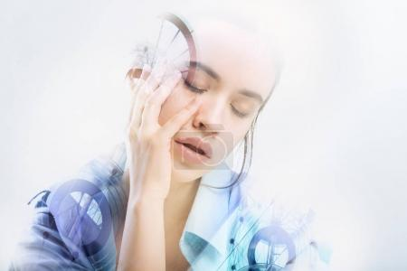 Tired woman closing her eyes while feeling unwell