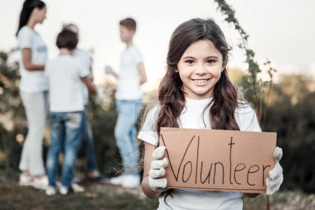 Happy cute girl being a volunteer