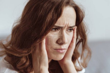 Close up portrait of woman struggling with headache