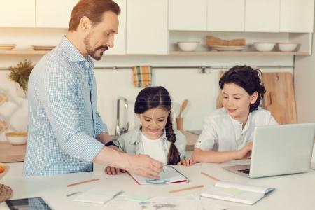 Positive joyful children studying