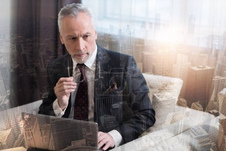 Concentrated male entrepreneur thinking about new business strategy