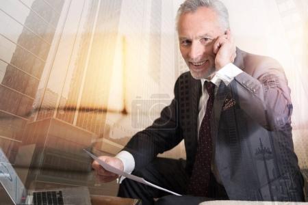 Positive minded entrepreneur having phone conversation