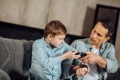 Irritated father and son fighting over a phone