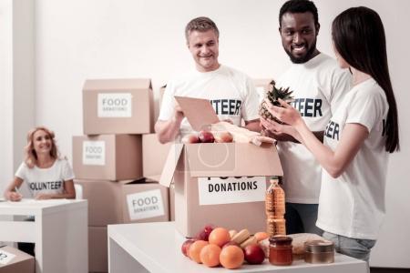 Group of volunteers packing humanitarian help