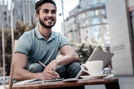 Excited bearded man generating ideas outdoors