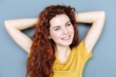 Delighted relaxed woman smiling to you