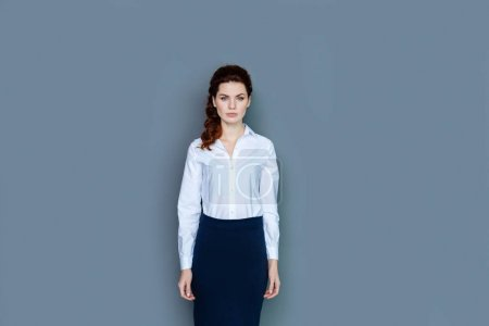 Smart confident businesswoman looking at you