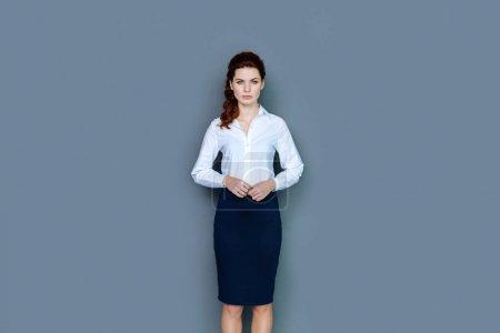 Cheerful confident businesswoman smiling