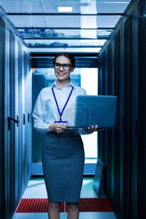 Joyful woman holding her laptop