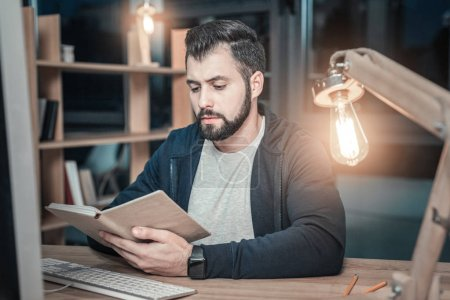 Smart IT guy reading book