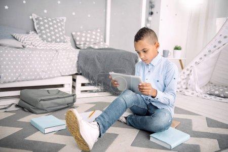 Earnest nice boy involving in online learning