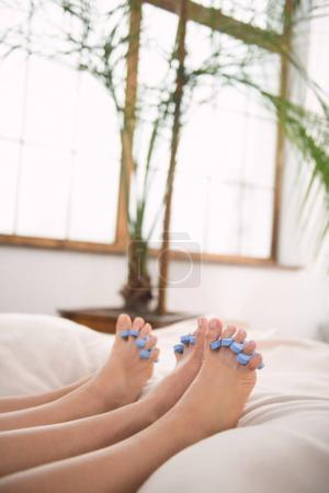 Female feet with toe separators