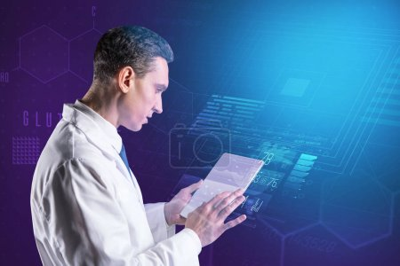 Photo for Scientific research. Clever curious hardworking doctor feeling interested while looking at the screen of a modern tablet - Royalty Free Image