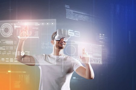 Photo for Happy employee. Emotional young cheerful programmer smiling and feeling happy while wearing virtual reality glasses and looking impressed by the new opportunities - Royalty Free Image