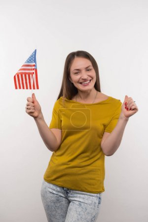 Positive young woman supporting her country