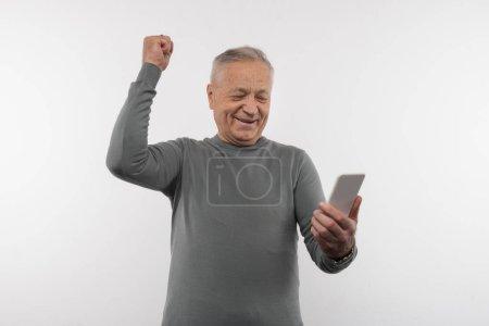 Joyful aged man feeling happy