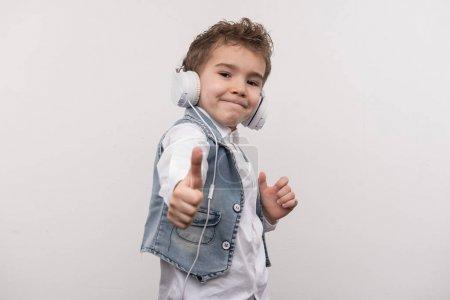 Joyful positive boy showing Ok sign