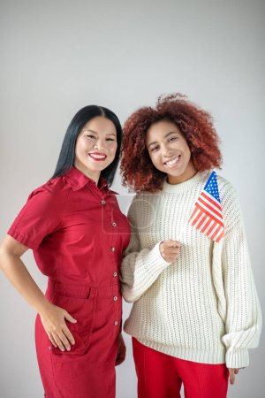Photo for Celebrating Independence day. Two stylish cheerful friends celebrating Independence day together - Royalty Free Image