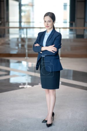 Photo for Appealing young successful businesswoman feeling excited and motivated - Royalty Free Image