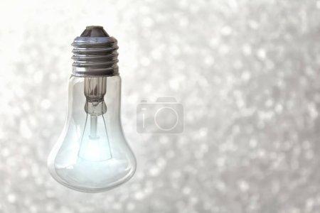 Light bulb on gray