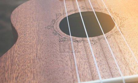 close-up photo of Ukulele little wooden guitar