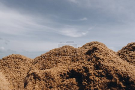 View of sand piles and cloudy background