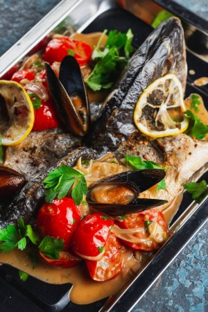 Photo for Baked fish with mussels on tray - Royalty Free Image