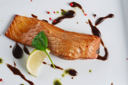 Photo for Salmon with sauce on white plate - Royalty Free Image