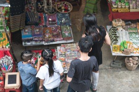Family shopping on city market