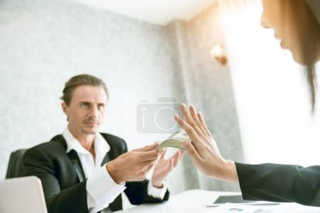 Businessman refusing money in the