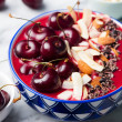 Smoothie bowl with fresh black cherries, coconut f...