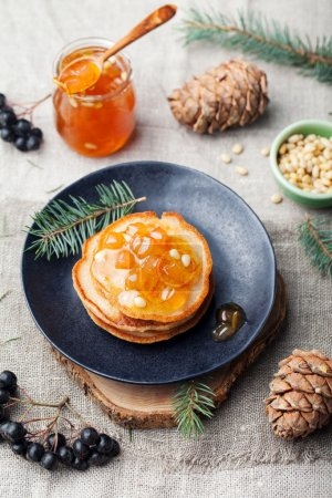 Christmas winter pancakes with pear, tangerine jam
