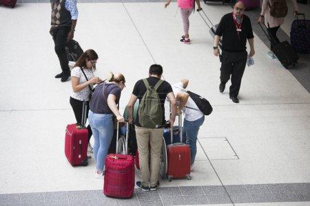 Passengers at Liverpool Street Station, London, UK