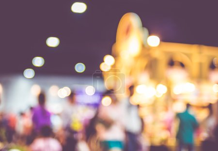 Photo for Blurred background: crowd of people in expo fair with bokeh light ,Vintage filter. - Royalty Free Image