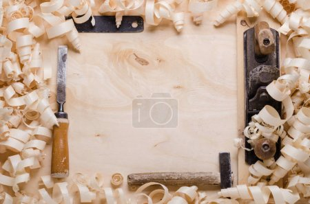 wood shavings on a wooden background with tools