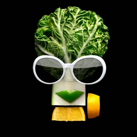 Tasty art. Quirky food concept of cubist style female face in sunglasses made of fresh fruits on black background.