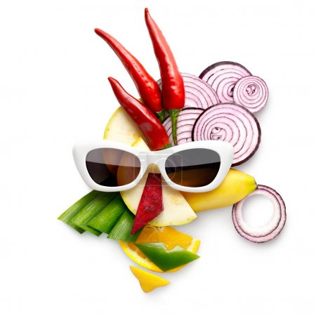 Tasty art. Quirky food concept of cubist style female face in sunglasses made of fruits and vegetables, on white.